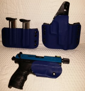 "Here is a Walther P-22 with a beautiful blue belt holster and ""Bikini"" style holster.  Yes the threaded barrel is covered by the holster"