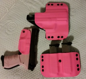 "Here we have another Walther using pink for the holster, magazine pouch and ""Bikini"" holster"